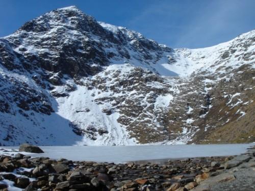 Frozen lake at Llyn Llaslyn Snowdon