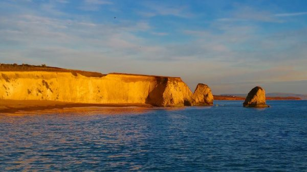 The Mermaid and Stag Rocks just before sunset - HF Holidays Freshwater Bay House Isle of Wight